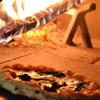 ピッツェリア ピッキ - 料理写真:最短1分半。500度薪焼き。 ピッツァ マリナーラ 1000円~2500円(全50種類以上)