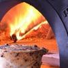 ピッツェリア ピッキ - 料理写真:窯焼き秋田産「赤べこ牛」の煮込み、ピザ生地包み 1600円
