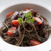 OUI - 料理写真:『イカスミとプチトマトのパスタ』 スミの香りが食欲をそそる自慢の一品。