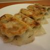 東林 - 料理写真:「餃子」 キャベツ・ニラ・長ネギ・ひき肉を使って、野菜の配分を多くしニンニクを効かせた自家製餃子です。5個入り\680