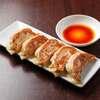 麺道 麒麟児 - 料理写真:人気のジューシー餃子450円