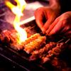 炭火焼鳥 たまどん - 料理写真:備長炭で焼き上げる