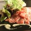 ビストロ テソロン ウナ ベッコ - 料理写真:鹿児島黒牛A5を使ったカルッパチョ 1800yen