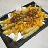 けんめり - 料理写真:アメリカンポテト400円とろ~りチェダーチーズどベーコンチップをトッピング