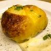 グルグル イタリア食堂 - 料理写真:国産鶏モモ肉のごはん詰め 4種チーズのクアトロ・フォルマッジソース添え