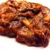 焼肉 くまちゃん - 料理写真:特製の味噌ダレで漬けた名物くまちゃん