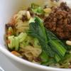 麺屋遊膳 - 料理写真:汁なし担々麺。半熟味付け玉子との相性も抜群です。ぜひお試しください!