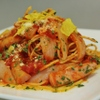トラットリア ヒューメ - 料理写真:京都ポークソーセージ・玉葱の辛口トマトソース湯葉チップスがけ