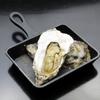 キタバル - 料理写真:【2月の殻付きがき100円フェア】焼きがきのガーリックバターソース 一個100円