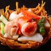 Restaurant NIHIRO 北千住 - 料理写真:海鮮の炒め さつまいもの籠の中に