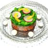 ビッグジョー - 料理写真:『魚介のタルタル 菜の花仕立て』550円(税込) サーモン・潮鯛・ムキ海老を小さく刻み、調味してセルクル型で仕上げました。菜の花特有のほろ苦さが魚介と良く合います。ソースと混ぜてご賞味下さい。春の季節にお薦めのオードブルです。