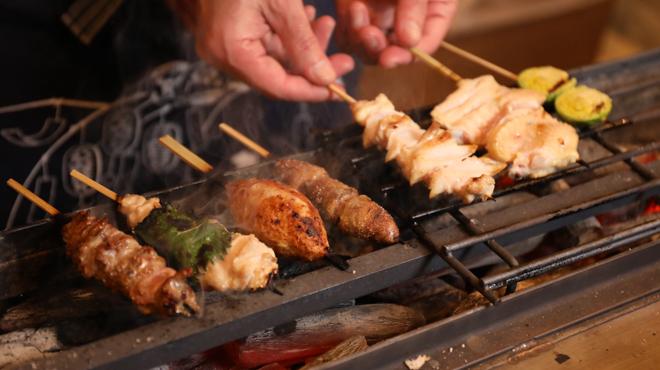炭火串焼台所 ちっきん はなれ - 料理写真:焼いてる手元アップ