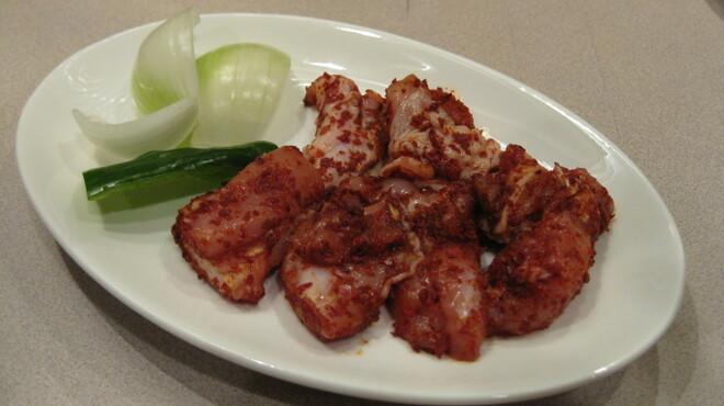 綾屋 - 料理写真:鶏モモ 辛口タレ