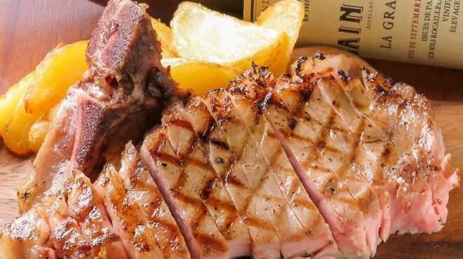 肉フレンチビストロGowanfure - 料理写真:骨付き霧島ヒナモリポークのグリル