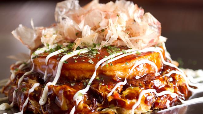 ごっつい - 料理写真:プロが焼く、最高のお好み焼!山芋たっぷりのせ豚肉入り!『ごっつい』NO,1のお好み焼!