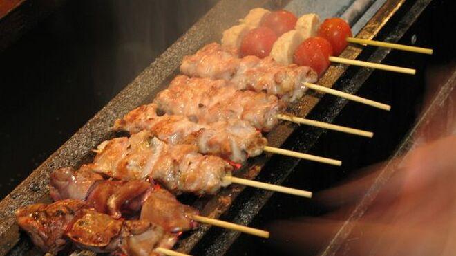 鳥吉 - 料理写真:当店自慢の炭火焼の串焼きです。一番人気はくび焼です。