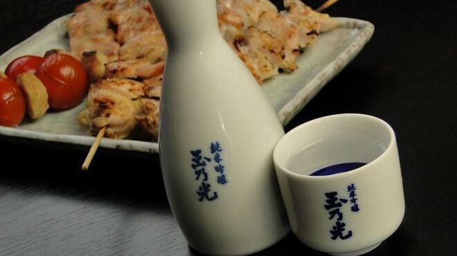鳥吉 - 料理写真:サイドメニューでも人気ナンバー1の手羽ギョーザ。肉汁が溢れます。