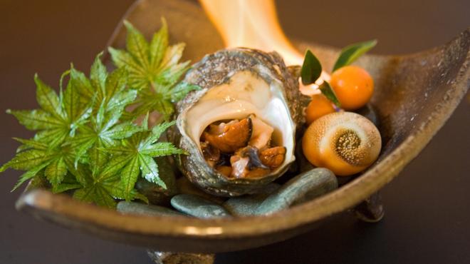 四国三郎 よしの川 - 料理写真:活さざえの壺焼き