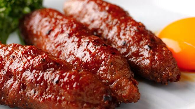 鳥源 - 料理写真:鶏つくね 当店1番人気。濃厚な黄身をつけてお召し上がりくださいませ!