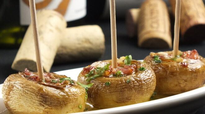 スペインバルエルソル - 料理写真:新登場!マッシュルームと生ハムのオーブン焼き