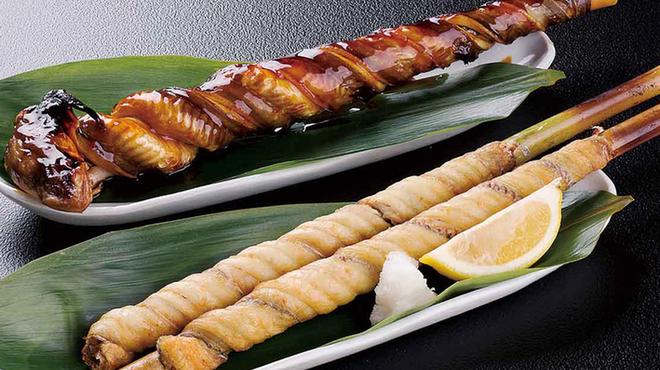 蓮 - 料理写真:穴子ぐるぐる焼き980円/太刀魚ぐるぐる焼き1本580円2本980円
