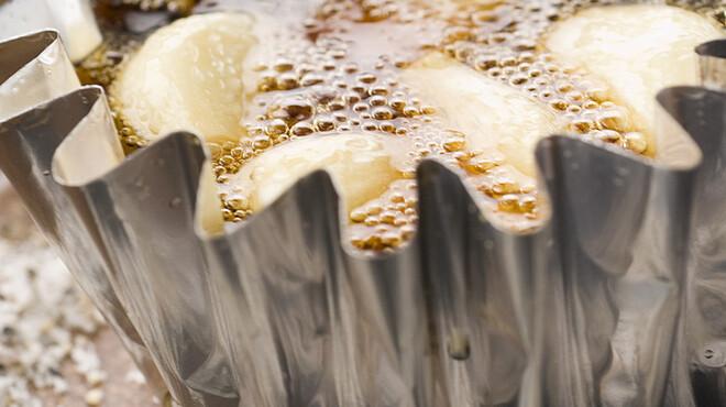 ひつじ家。 - 料理写真:ニンニクホイル~胡麻油の香りがとてもいい。スタミナをつけたい方おすすめの一品です。