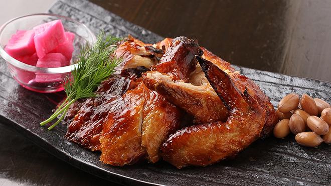 チャイナ食堂 九龍 - 料理写真:若鶏のパリパリ香り揚げ(半羽)