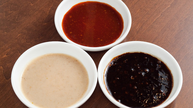 KITCHEN TACHIKICHI - 料理写真:特製の餃子のタレ!赤のピリ辛・黒のさっぱり・味噌マイルドと選べる3種ダレ
