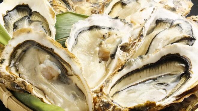 漁火 - 料理写真:殻付牡蠣焼