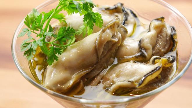 ガンボ&オイスターバー - 料理写真:広島産牡蠣のオリーブオイルマリネタプナードソース