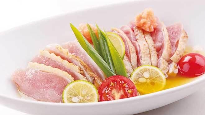 鳥蔵黒船  - 料理写真:さつま知覧鶏のたたき 白ポンまみれ