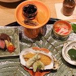 御幸町 田がわ - 鳥羽市浦村牡蠣フライ、たらの芽、ふきのとう、ランプ肉、三陸のあわび、紅白かきなます、黒豆、たつくり、数の子