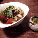 スリランカ料理専門店 居心地屋REON - 牛すじ肉の煮込み。牛すじ煮込み・酢もつ・豚足があると絶対注文してしまいます。