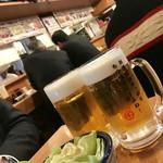 もつ千 - 生ビール¥499(外税) お通し¥299(外税)…塩ダレキャベツ