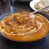 アーンドラ・カフェ - 料理写真:バターチキンカリー 990円。プルカ 390円。