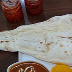 100650602 - Asian Dining & Bar New Maharaja @ときわ台 大きなナンはモチモチ食感は愉しめるもののパリパリ食感は皆無