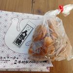 元祖木村家人形焼本舗 - ビニール袋に入ってます