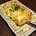 プライベート個室×旬菜居酒屋 魚々ろ - 炙りマヨチース明太だし巻き。