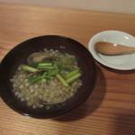 101443468 - お通しの「蕎麦の実雑炊」