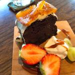 ショコラ - 料理写真:◆オレンジジェットのガトーショコラ 850円 コーヒーまたはカフェラテ付き