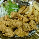 酒菜屋たぬき - ちょっと、カレー風味の鳥の唐揚げ1,000円。凄いボリューム