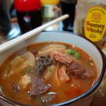 中華料理ぼたん - 料理写真:もつ煮込み600円。