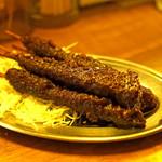 大衆酒場コグマヤ - 煮汁に浸した無限 味噌カツ