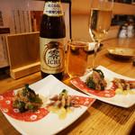 102663824 - お通しは、真鯛とアスパラ菜の胡麻和え・蛍烏賊とのびるの酢味噌です。