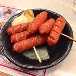 元祖立ち飲み屋 - 赤ウィンナー串250円