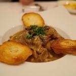 ラ・ターボラ - 鶏肉のポルチーニ煮込み
