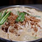 ワイン&焼酎 KURIKI 九州料理の店 - 坦々もつ鍋(Sサイズ)