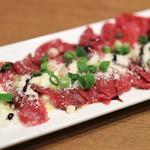 103024832 - 桜肉のカルパッチョ。
