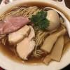 だし廊 - 料理写真:整った丼面も定石通りな「熟玉 飛魚だし醤油そば」