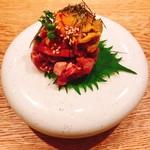 103437266 - 雲丹、ユッケ、卵黄のコラボが最高のオリジナル料理です(o^^o)